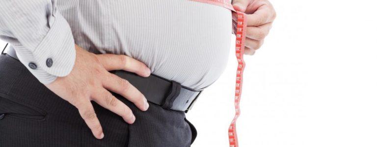 a-man-measuring-his-waist